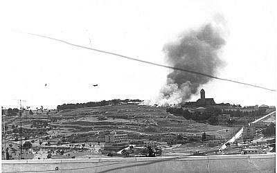 Smoke billows from a Jordanian trench position after an Israeli jet drops napalm canisters. Paratroopers subsequently attacked along the ridge from Mount Scopus to the left and up the slope from Wadi Joz but the defenders had already fled. (photo credit: Bamahane)