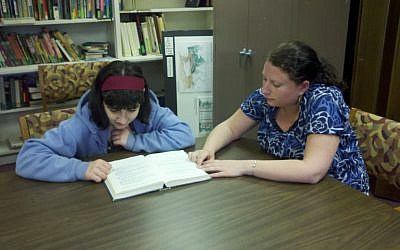 Student Emma Weihrauch with tutor Leanne Pelser at Temple Beth Emunah in Brockton, Mass. The temple offers children with attention deficit hyperactivity disorder special programs to help them study for their bar/bat mitzva ceremonies. (photo credit: Temple Beth Emunah/JTA)