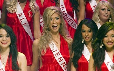 Transgendered beauty queen Jenna Talackova, center, appears in the Miss Universe Canada pageant in Toronto on Saturday May 19, 2012. (photo credit: AP Photo/The Canadian Press, Chris Young)