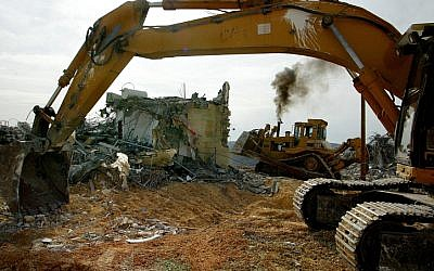 Bulldozers demolish a house during the evacuation of the West Bank outpost of Amona in 2006. Resident of the current outpost hope a hunger strike will prevent a repeat of the events. (photo credit: Olivier Fitoussi/Flash90)