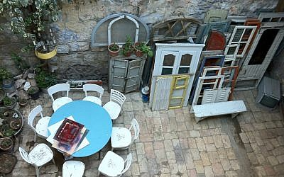 Salvaged frames and doors in the Tower and Story Museum and Robbers of Jerusalem Gallery's outdoor sitting area. (Photo credit: Greg Tepper)