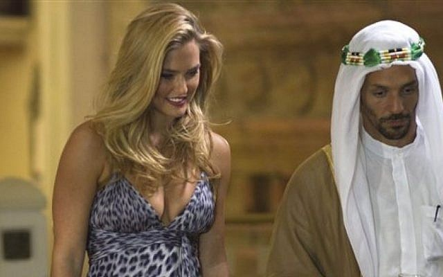 Israeli model Bar Refaeli plays a Mossad seductress with actor Tomer Sisley on a set of a film made about the assassination of Hamas operative Mahmoud al-Mabhouh (AP/Dan Balilty)