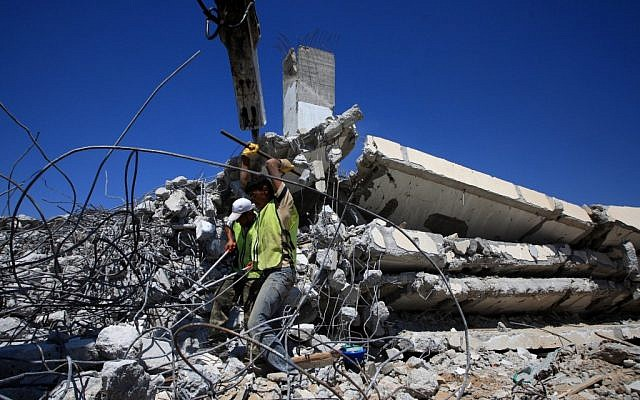 Palestinians clear the rubble of a destroyed house in Gaza in 2009 (photo credit: Wissam Nassar flash90)