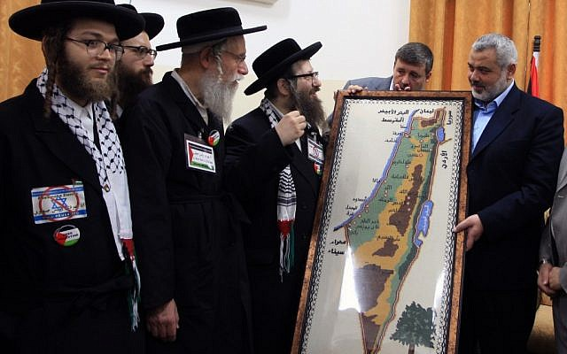 In this 2009 file photo, Hamas PM Ismail Haniyeh presents Neturei Karta supporters with a map of 'Palestine' (photo credit: Wissam Nassar/Flash90)