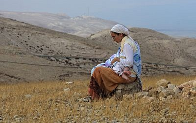 A mom nursing on a hilltop (photo credit: Nati Shohat/Flash 90)