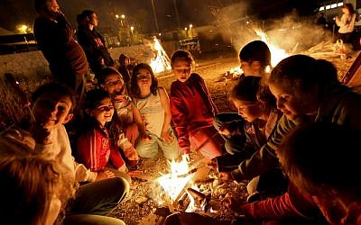 Children gather around the Lag Ba'omer bonfire outside Jerusalem, 2010. (photo credit: Nati Shohat/ Flash90)