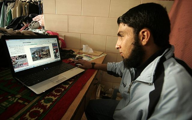 A Palestinian man surfs the Internet in Rafah, the southern Gaza Strip, in 2011. (photo credit: Abed Rahim Khatib/Flash90)
