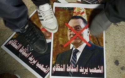 Protesters stomping on a picture of Hosni Mubarak outside the Egyptian Embassy in Tel Aviv in 2011. (photo credit: Flash90)