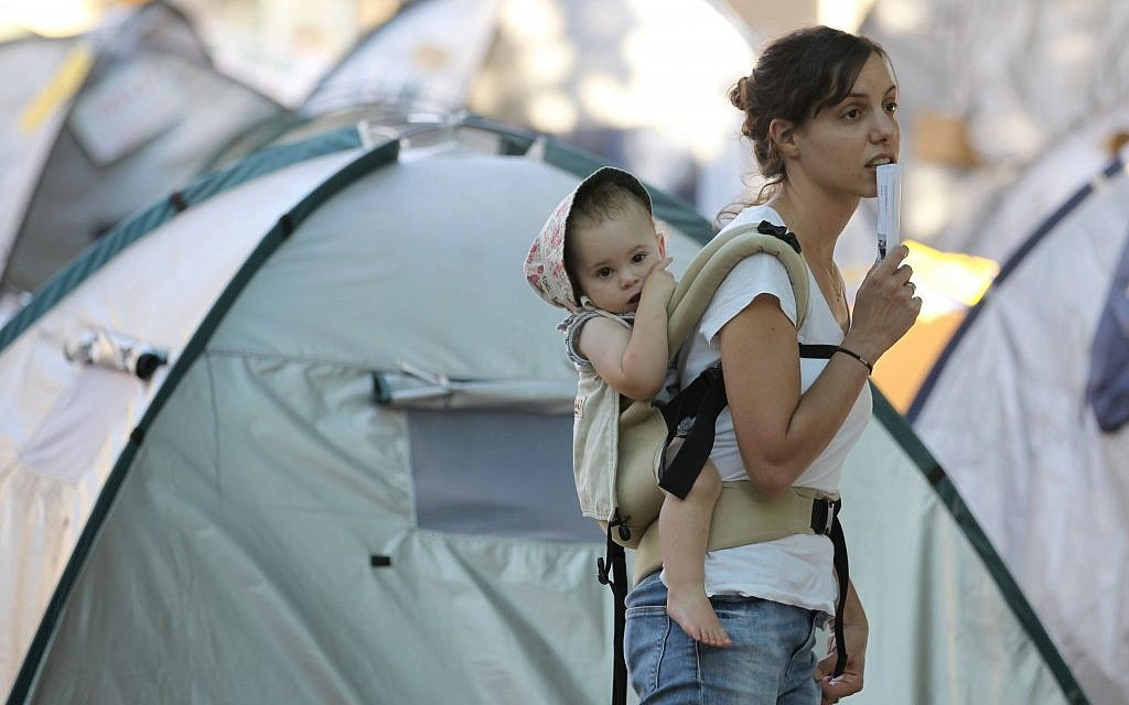 A mother wearing her baby at the 2011 summer protest (photo credit: Nati Shohat/Flash 90)