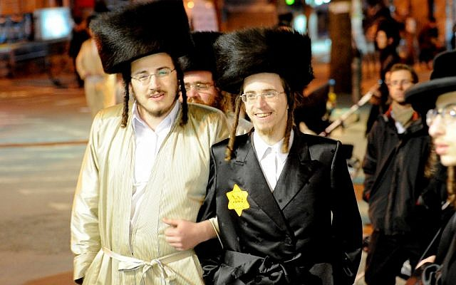 An ultra-Orthodox man wearing a yellow badge at a rally in Jerusalem in December 2011 (photo credit: Flash90)
