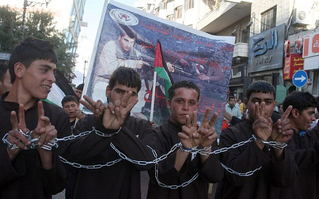 Illustrative photo of boys taking part in a rally in support of Palestinian prisoners waging a hunger strike in Israeli prisons. (photo credit: Issam Rimawi/flash90)