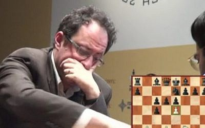 Boris Gelfand makes a move in the 12th game of the World Championships of Chess title contest in Moscow on Monday. (screen capture from live feed of match)