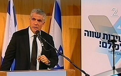 Yair Lapid addresses supporters Tuesday at the first political rally for his newly formed Yesh Atid (There is a future) party (photo credit: screenshot courtesy Channel 2)