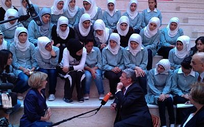 German President Joachim Gauck, center, chatting with students at a newly dedicated girls school in Burin, south of Nablus. (photo credit: Raphael Ahren/The Times of Israel)