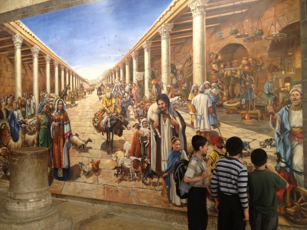Boys examine a mural in the Jewish Quarter (Photo credit: Matti Friedman)