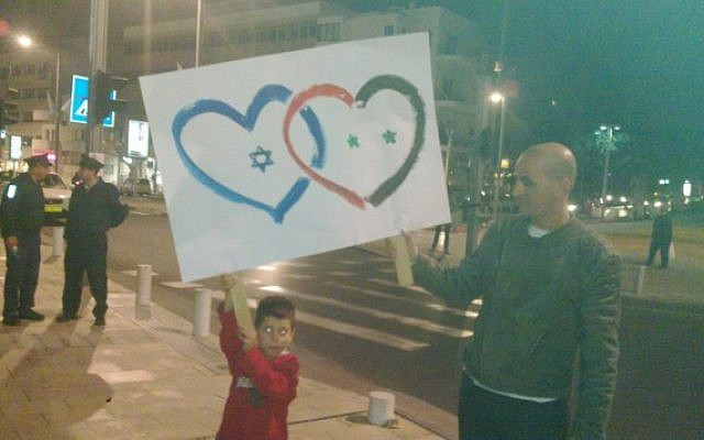 A Tel Aviv demonstration in solidarity with Syrian civilians on March 31 (photo credit: @Elizrael via Twitter)