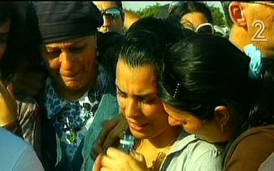 Family and friends of Gadi Vichman attend his funeral on Sunday (photo credit: screenshot courtesy Channel 2)