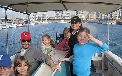 Leah Lipman (standing, in black) on a boat in Ashdod with Dov and his family (photo credit: Courtesy Leah Lipman)