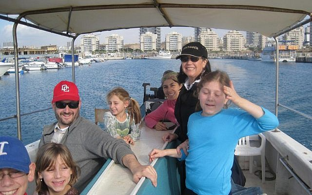 Dov Lipman, left, on a boat in Ashdod with his wife Leah (standing, in black) and his family (photo credit: Courtesy Leah Lipman)
