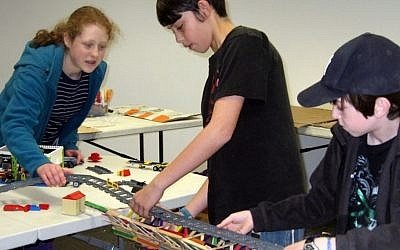 Tech-Know-Play campers work on a bridge engineering project (Photo credit: courtesy)