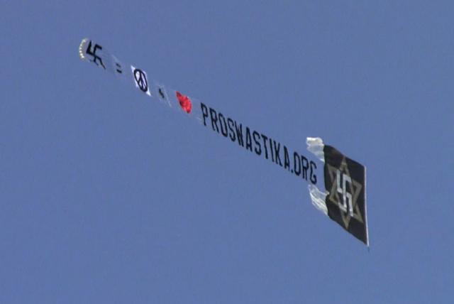 Raelians get the word out about swastika rehabilitation (photo credit: via Corey Kilgannon's Twitter)