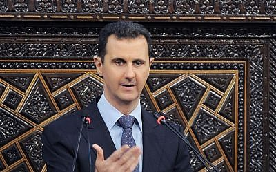 Syrian President Bashar Assad delivers a speech at the parliament in Damascus, Syria, in June (photo credit: SANA/AP)