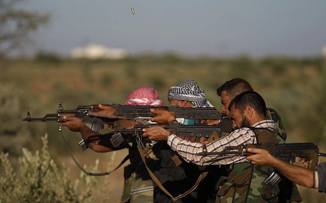 Free Syrian Army members fire at targets as they train on the outskirts of Idlib, Syria, Thursday (photo credit: AP)