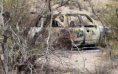 The Butwins' torched car, found in the desert. (photo credit: (AP/ Pinal County Sheriffs Office)