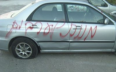 Graffiti reading 'Death to Arabs' spray-painted on cars at Neve Shalom. (photo crediti: keano_16, Twitter)
