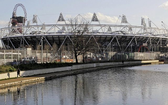 The main Olympic Stadium in London. Security forces are working overtime on preparations for the games. (photo credit: AP/Sang Tan)