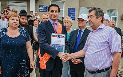 Matthew Bronfman, center, is made an honorary citizen by the mayor of Otaci, the town in Moldova where his great grandfather Samuel Bronfman was born. (photo credit: Niv Shimshon/ Limmud FSU/JTA)