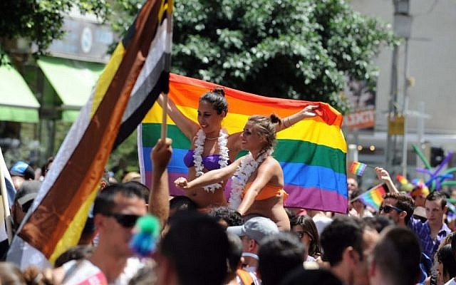 Supporters soaked up the sun as the 2011 gay pride parade marched down Ben Yehuda Street in Tel Aviv (photo credit: David Katz/The Israel Project)