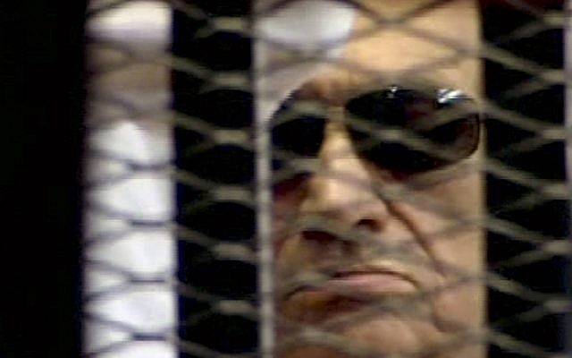 In this video image taken from Egyptian State Television, 84-year-old former Egyptian president Hosni Mubarak is seen in the defendant's cage as a judge reads the verdict on charges of complicity in the killing of protesters during last year's uprising that forced him from power, in Cairo, Egypt, Saturday (AP/Egyptian State TV)