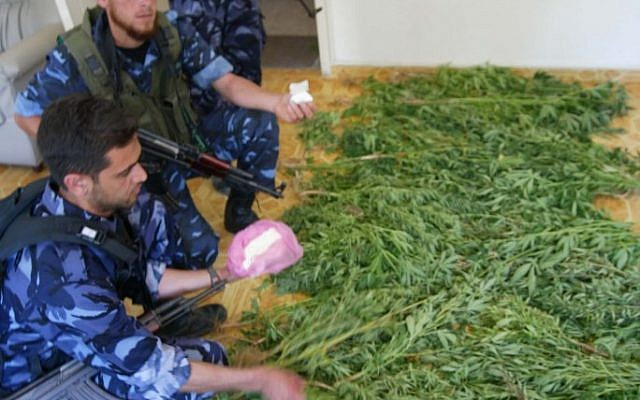 Illustrative photo of Hamas police officers with confiscated drugs (photo credit: Ahmad Khateib/ Flash90)