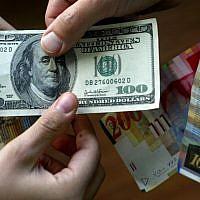 Dollars and shekels (photo credit: Olivier Fitoussi/Flash90)