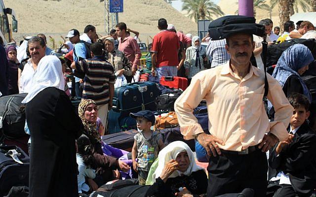 Palestinians wait at the Allenby Bridge border crossing between Israel and Jordan (photo credit: Kobi Gideon/Flash90)