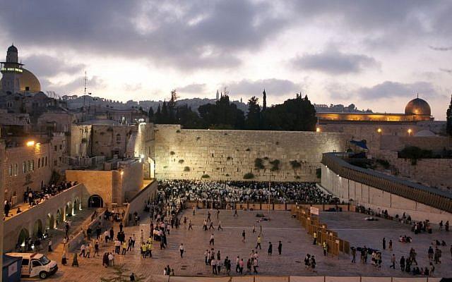 Illustrative photo of Jewish worshipers praying at the Western Wall in Jerusalem's Old City (Matanya Tausig/Flash90/File)