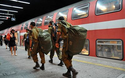 Soldiers board a train in Tel Aviv (photo credit: Shay Levy/ Flash90)