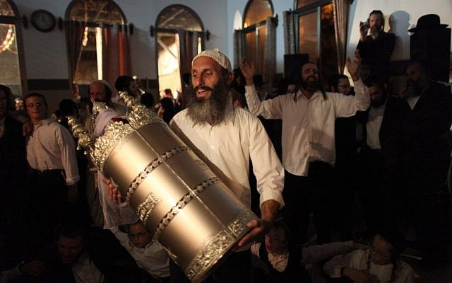 Israelis dance with the Torah scroll during Simchat Torah celebrations in Beitar Illit in 2009. (photo credit: Nati Shohat/Flash90)