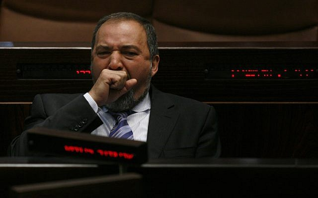 Foreign Minister Avigdor Liberman yawns during a Knesset plenary session (photo credit: Miriam Alster/Flash90)