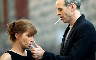 Director Samuel Maoz smokes a cigarette with his wife Laura (photo credit: Moshe Shai/Flash90)