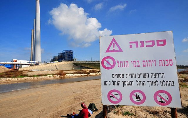 A sign warning the public of the danger of pollution in a river in Israel. (photo credit: Shay Levy/Flash 90)