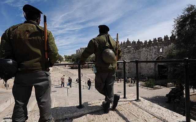 Israeli Border Police stand outside Damascus Gate of Jerusalem's Old City (illustrative photo credit: Gili Yaari/Flash 90)