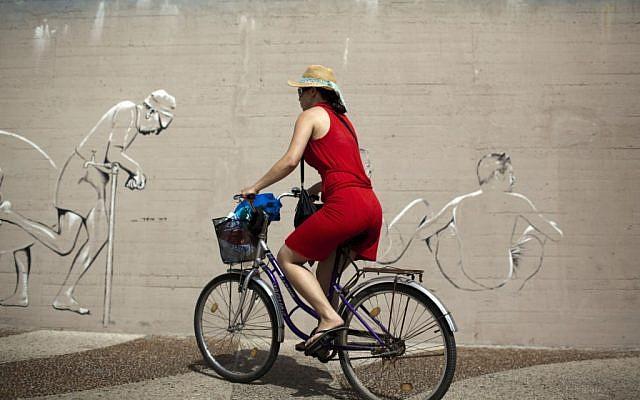Illustrative photo of a woman riding a bicycle. (Photo credit: Matanya Tausig/Flash90)