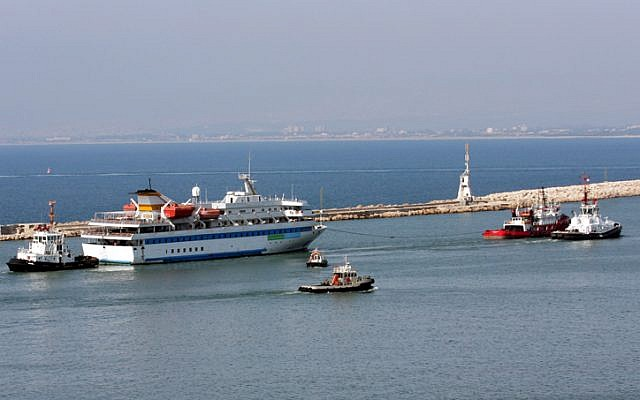 The Mavi Marmara is tugged out of Haifa harbor long after the raid (photo credit: Herzl Shapira/Flash 90)