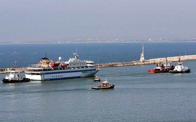 The Mavi Marmara being tugged out of Haifa harbor long after the raid (photo credit: Herzl Shapira/Flash 90)