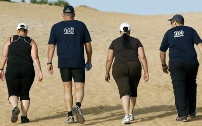 Illustrative photo of overweight people hiking at the Wingate institute in Israel. (Moshe Shai/Flash90)
