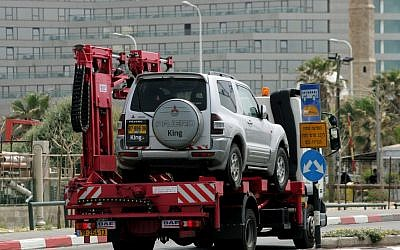 A car being towed in Tel Aviv in 2007 (illustrative photo credit: Moshe Shai/Flash90)