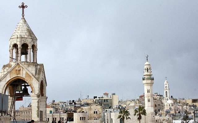 The Church of the Nativity (left) and the 19th-century mosque of Omar ibn al-Khattab looking over Manger Square in Bethlehem (photo credit: Najeh Hashlamoun/Flash90)