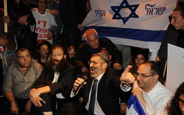 MK Michael Ben Ari (third from left) and right wing activist Baruch Marzel (second from left) at a Tel Aviv protest in 2011 (photo credit: Gili Yaari/Flash 90)